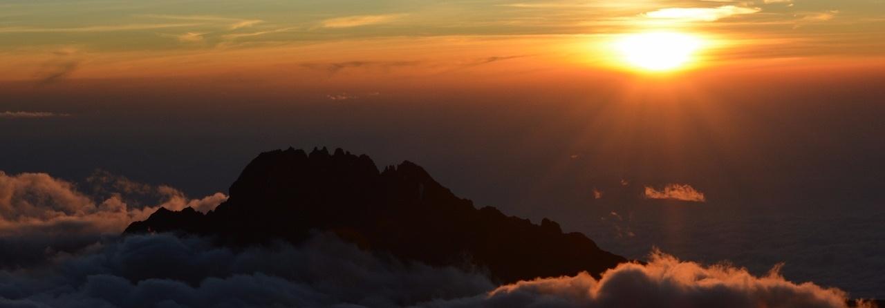 Kilimanjaro under a full moon. Climb Kilimanjaro to see the sunrise from Uhuru Peak