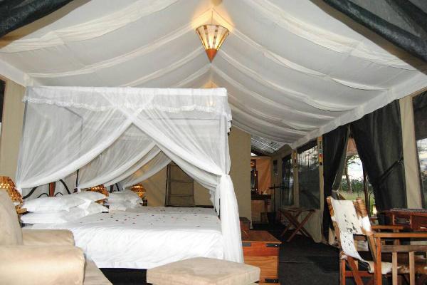 Double bed at Tanzania Bush Camp