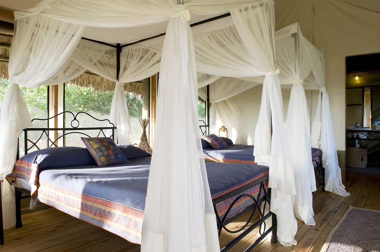 To see the inside of a tent at Lake Burunge Tented Lodge