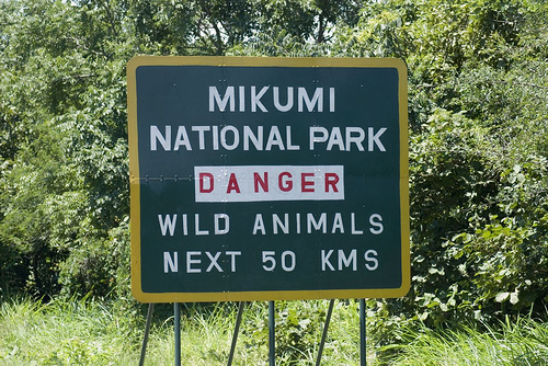Road sign by Mikumi National Park